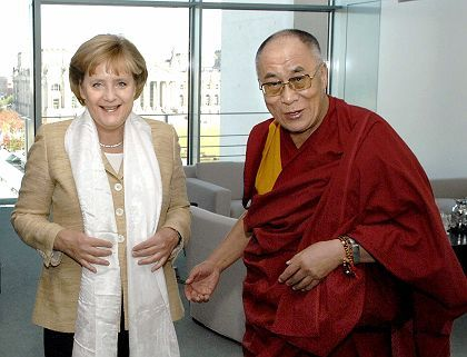 """German Chancellor Angela Merkel has been accused of """"shop window"""" politics for her visit with the Dalai Lama in September."""