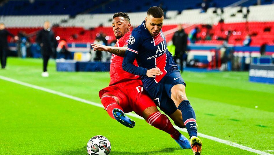 Jérôme Boateng (.) und Kylian Mbappé