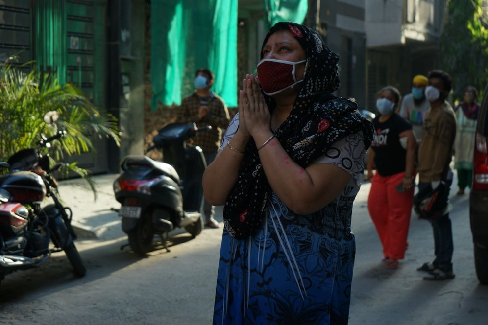 A woman in Delhi mourns the loss of her husband, who died of COVID-19.