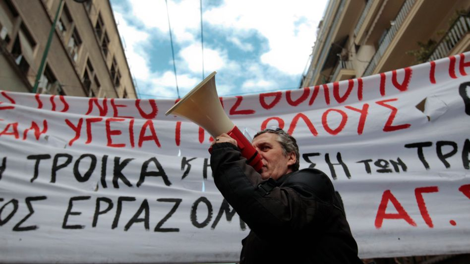 An anti-austerity rally in Athens. Germany's interior minister has called on Greece to quit the euro zone.