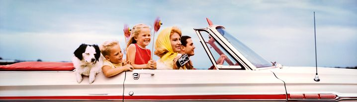 Family in convertible 1968 by Jim Pond