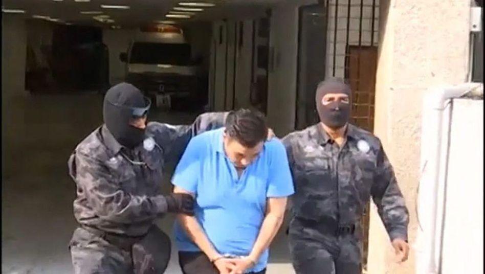 Mexikanische Polizisten, verhafteter Drogenboss: Umstrittene Methoden der Sicherheitskräfte
