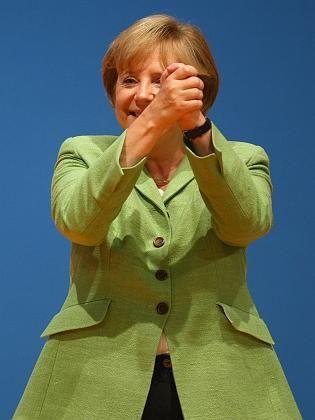 Heading for a second term? A confident Merkel at Monday's CDU/CSU party congress.