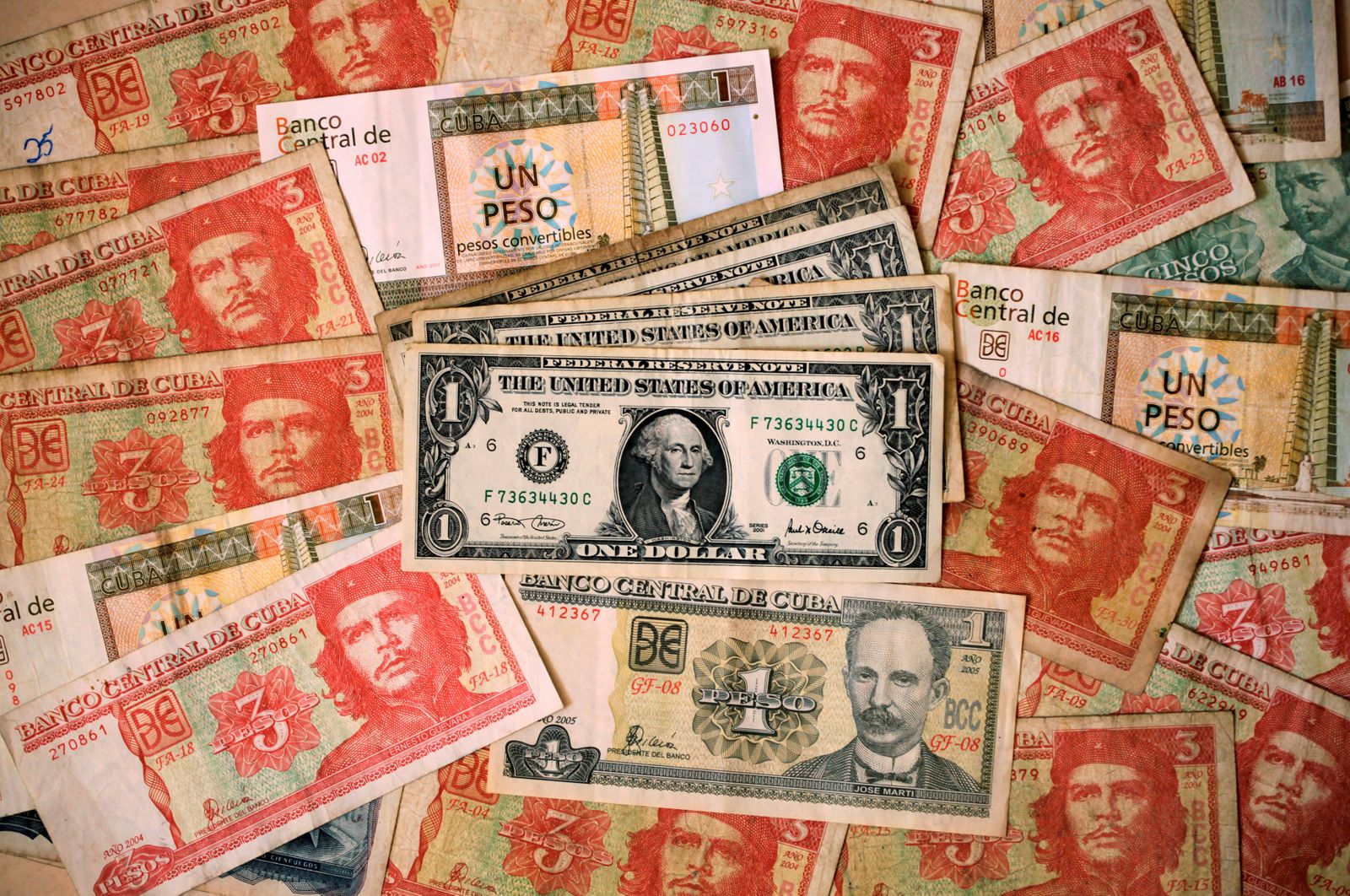 FILE PHOTO: Cuban and U.S. notes are seen in this illustrative photograph taken in Havana