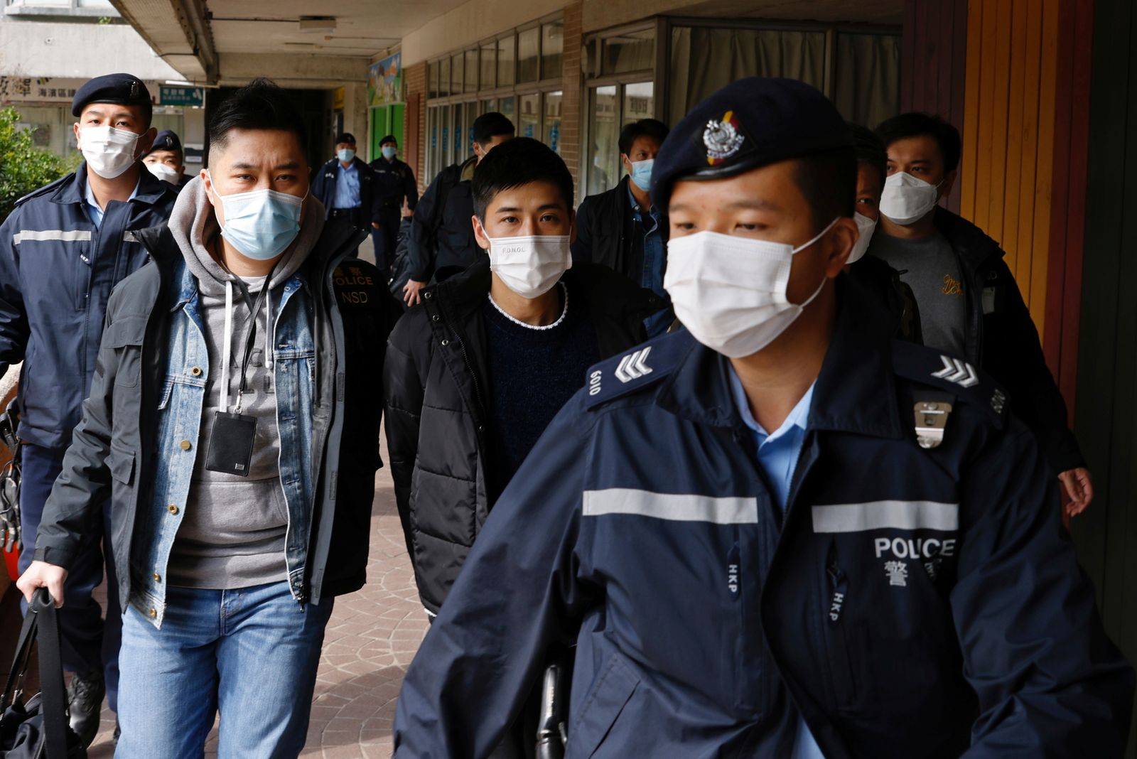 Pro-democracy activist Lester Shum is taken away by police officers in Hong Kong