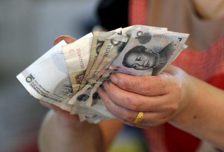 Yuan-Scheine: Chinesische Führung will die Landeswährung schwächen