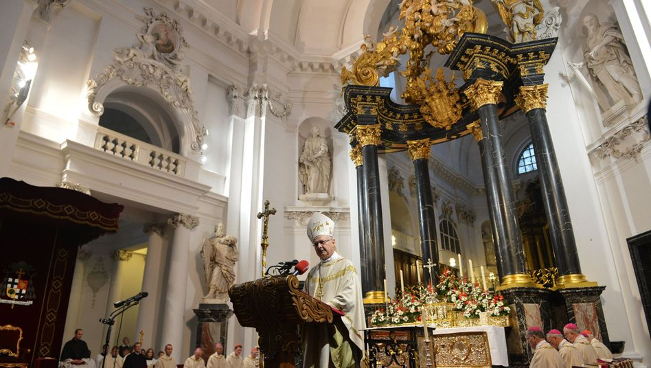"""Robert Zollitsch, archbishop of Freiburg and chairman of the German Bishops' Conference, said remarried Catholics """"belong to the Church."""""""