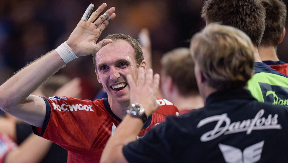 Holger Glandorf und Teamkollegen feiern
