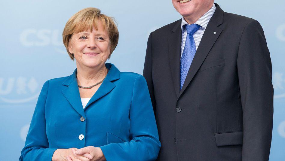Unions-Parteichefs Merkel, Seehofer: Geldregen kurz nach der Wahl