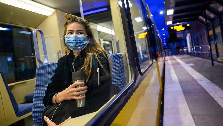 A woman wears a mask on a tram in Stuttgart, Germany.