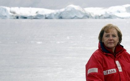 German Chancellor Angela Merkel, who took a trip to Greenland last year to highlight her environmental credentials, faces criticism for appearing to relax her stance on fighting global warming.