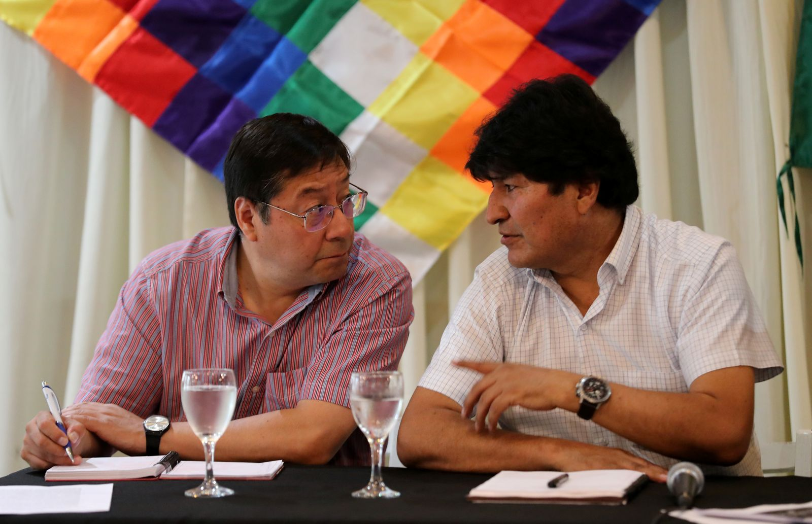 Former Bolivian President Evo Morales speaks to the presidential candidate for the Movement to Socialism party (MAS) Luis Arce Catacora during a meeting of their party, in Buenos Aires