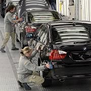 The falling dollar is pushing German car manufacturers like BMW to ship production overseas.