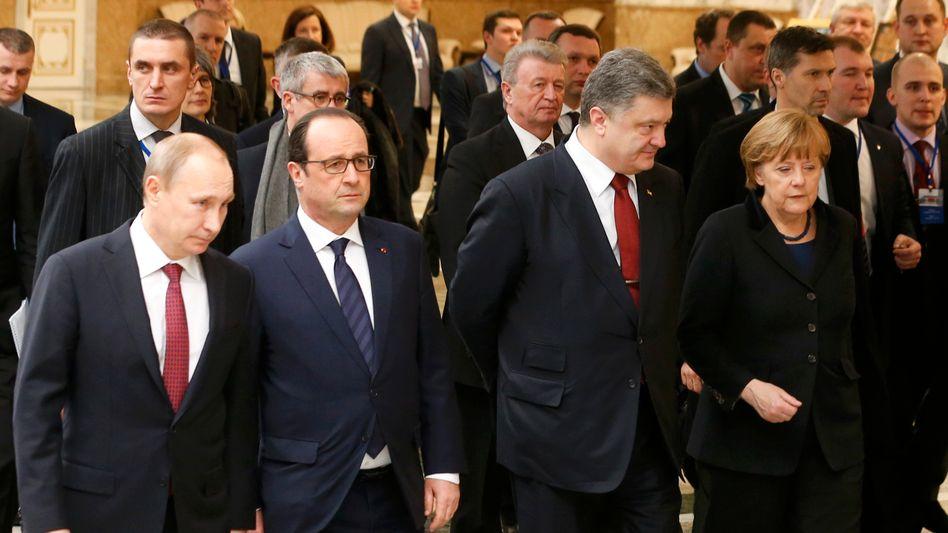 Minsk im Februar: Putin, Hollande, Poroschenko und Merkel nach den Gesprächen
