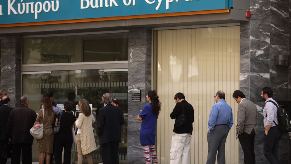 People queue up outside a bank in Nicosia: The bail-in seen in Cyprus will now be the standard for Europe.