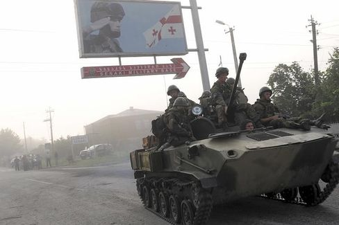Russian troops beginning to withdraw from parts of Georgia last Friday.