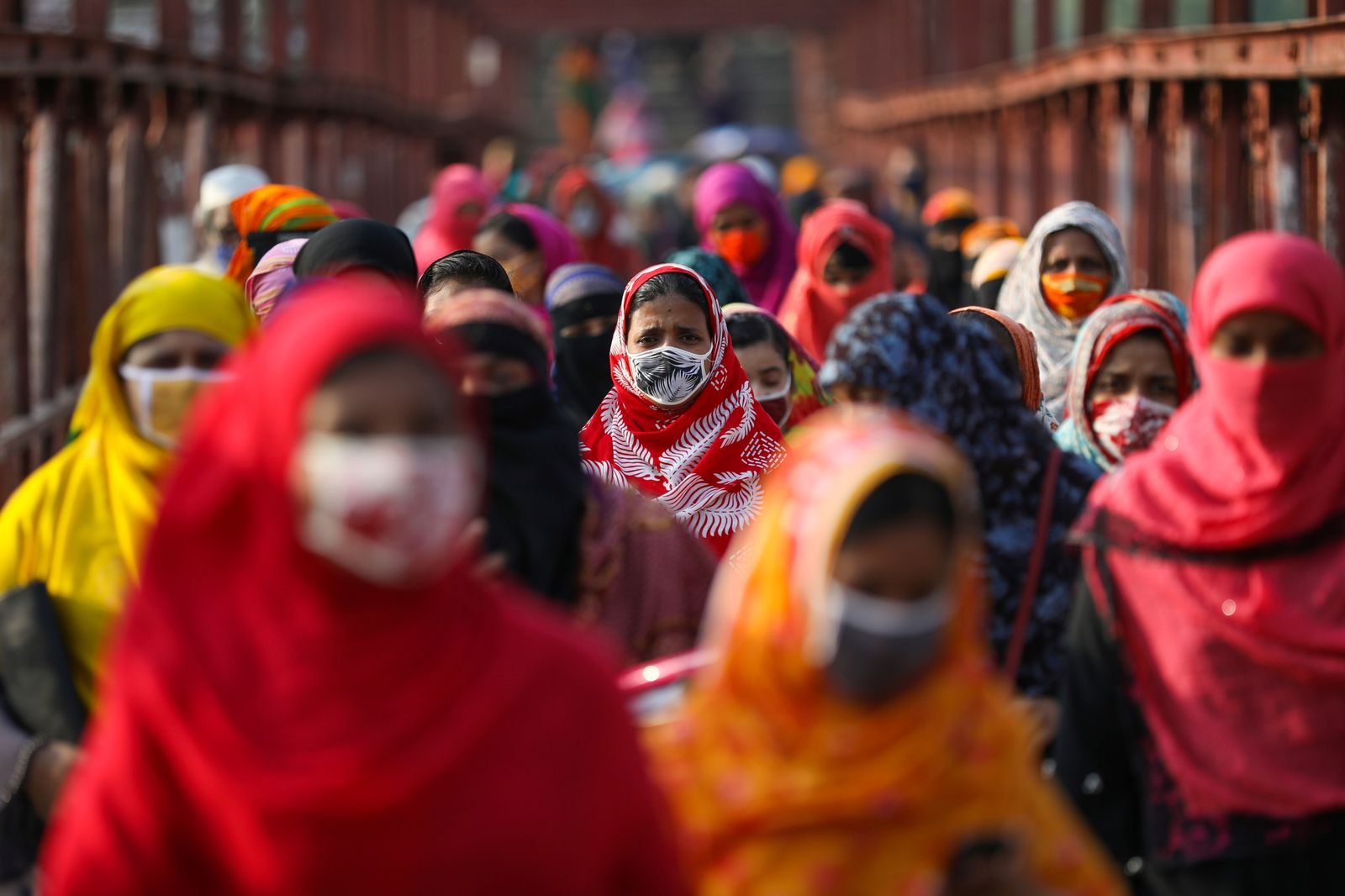 Garment workers return from a workplace as factories reopened after the government has eased the restrictions amid concerns over the coronavirus disease (COVID-19) outbreak in Dhaka