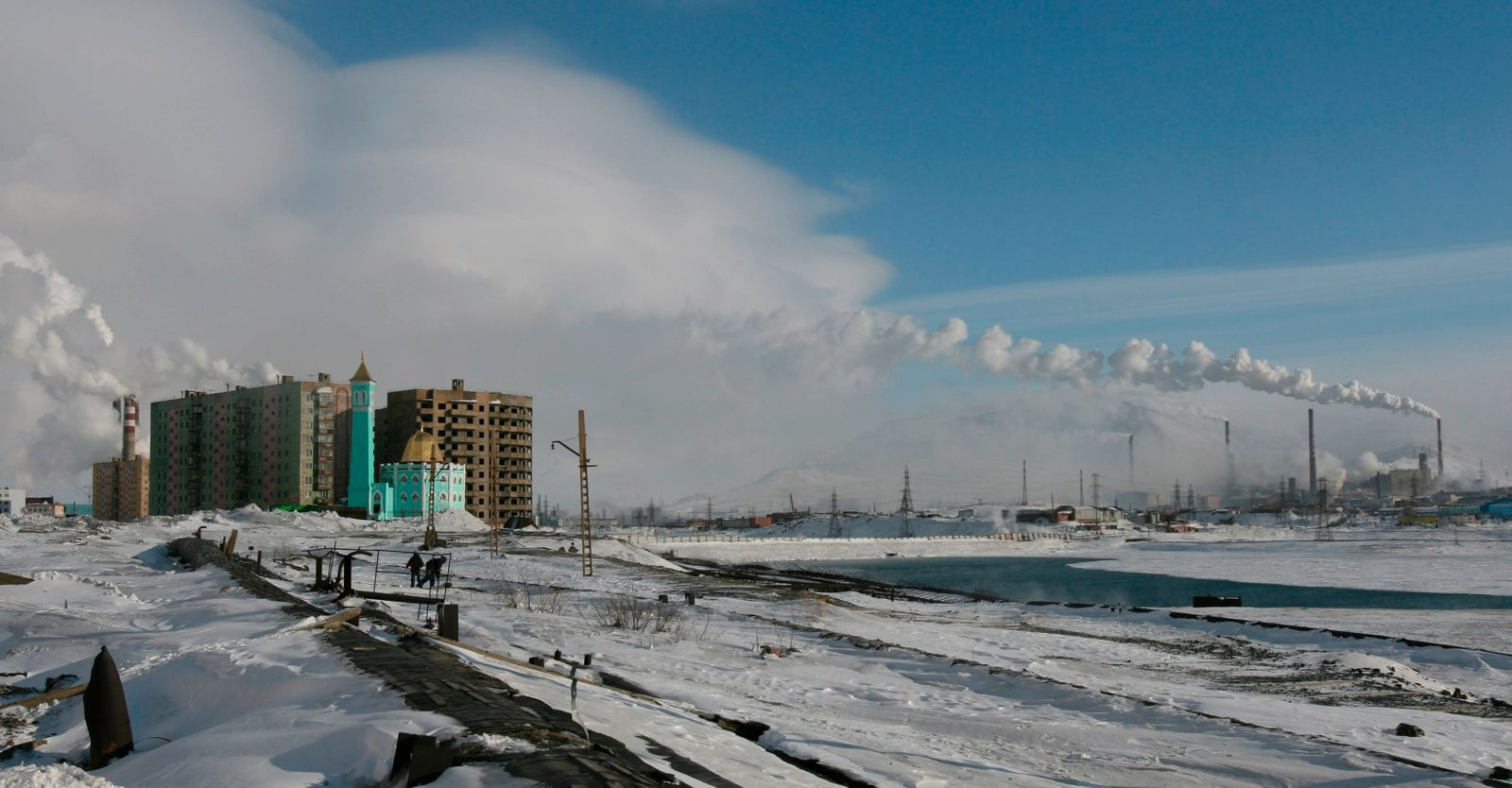 A general view shows the Nurd Kamal mosque, residential buildings and smelters in the arctic Russian city of Norilsk