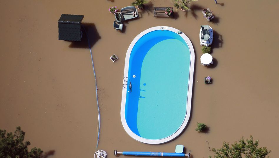 A swimming pool surrounded by floodwater along the Elbe River in the state of Saxony-Anhalt.