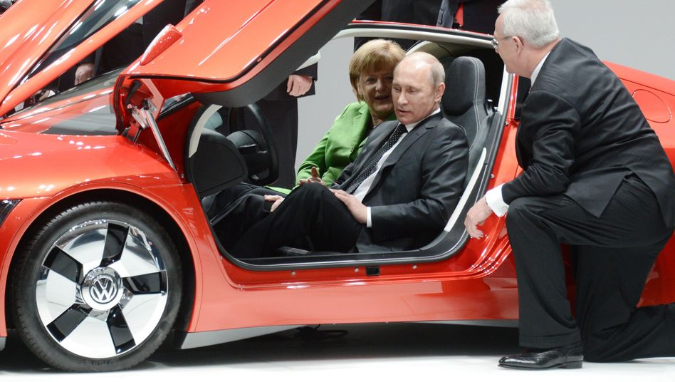 Angela Merkel and Russian President Vladimir Putin at the Hanover Trade Fair on April 8. The chancellor may be forced to make sanctions decisions that could negatively effect German businesses.