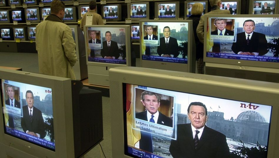 Televisions showing then-Chancellor Gerhard Schröder's response to US President George W. Bush's Iraq ultimatum. Schröder's former foreign policy advisor Michael Steiner said the US had plans for the use of nuclear weapons in Afghanistan following the Sept. 11, 2001 attacks.