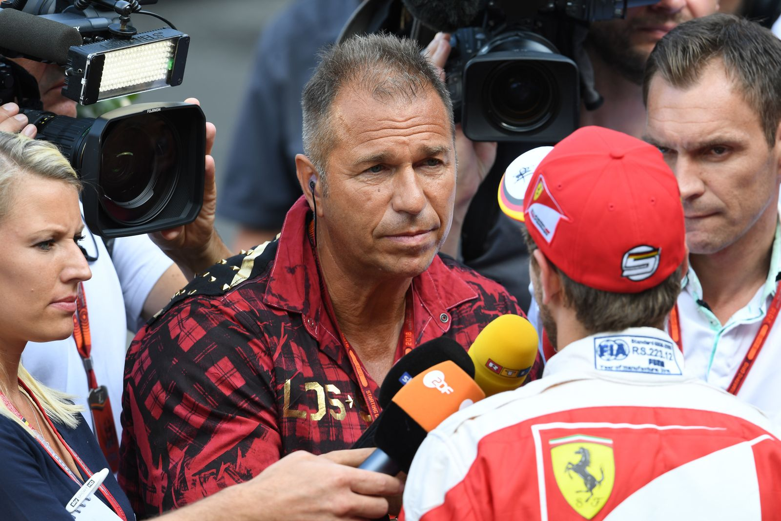 Belgian Grand Prix Sebastian Vettel (GER) Ferrari talks with Kai Ebel (GER) RTL Presenter at Formula One World Champions