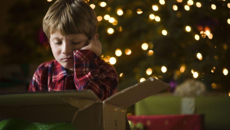 Unzufriedenes Kind an Weihnachten (Symbolbild)
