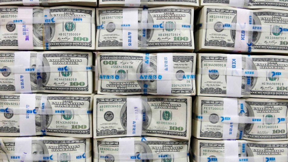 US-Dollarnoten (in Korea): USA aus dem Club der Elite-Schuldner verbannt