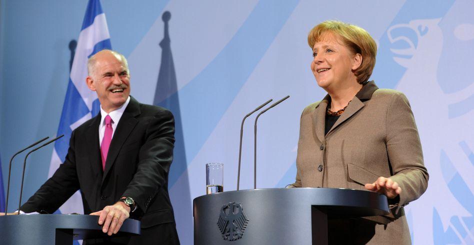 """Regierungschefs Papandreou, Merkel: """"Zögern und Zaudern"""" gegenüber den Griechen?"""