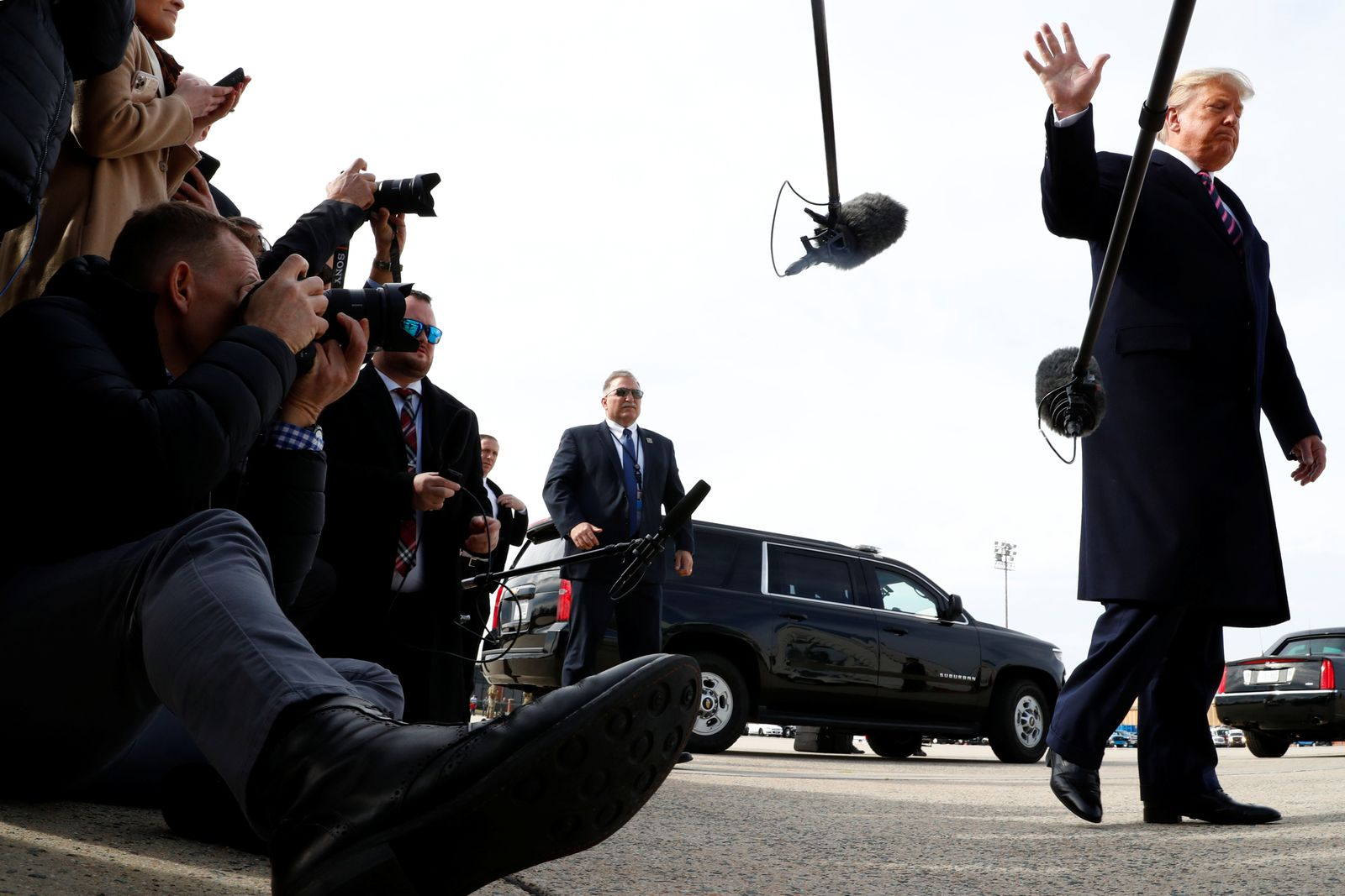 U.S. President Donald Trump speaks to members of the news media before boarding Air Force One at Joint Base Andrews in Maryland