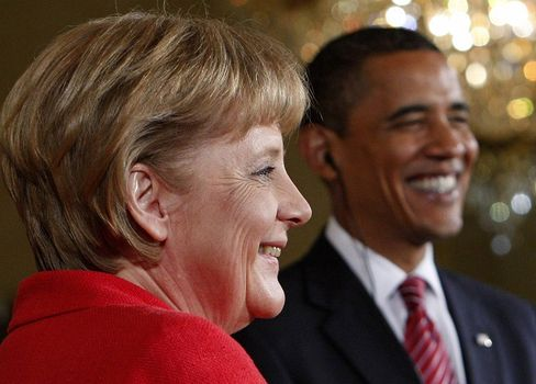 All smiles: Barack Obama is apparently confident that Angela Merkel will win re-election in September.