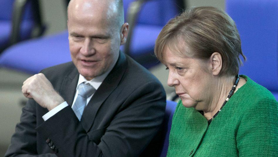 Unionsfraktionschef Ralph Brinkhaus (l.) mit Bundeskanzlerin Angela Merkel