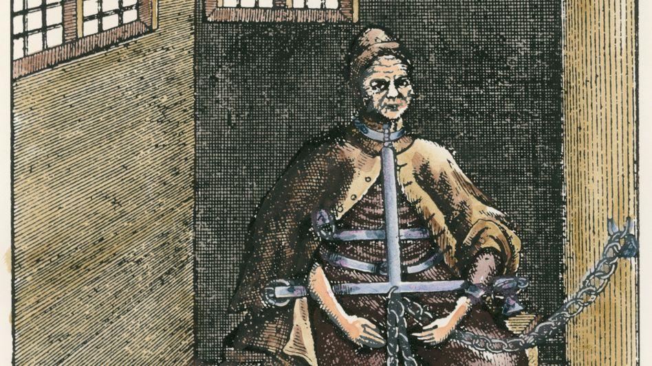Angekettet: Um 1627 errichteten die Bamberger Obrigkeiten mitten in der Stadt ein Hexen-Gefängnis, das Malefix-Haus. Der kolorierte Kupferstich zeigt eine Verdächtige in einer Zelle.
