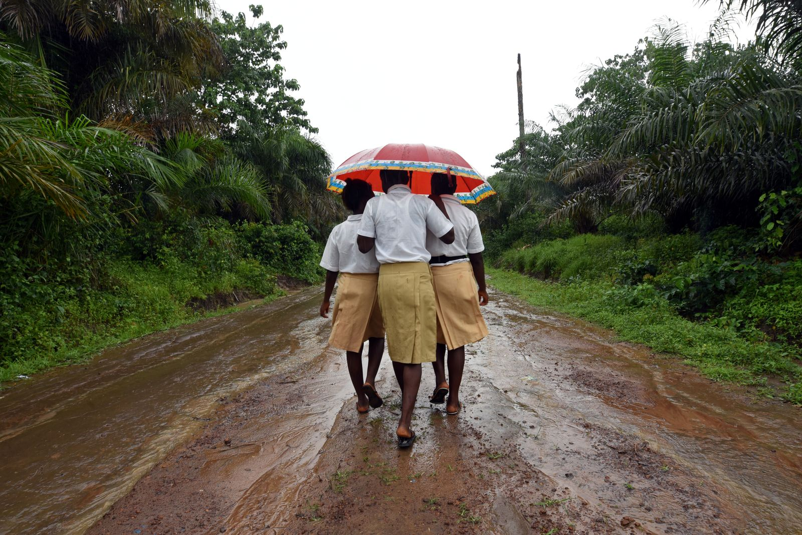 Mariatu Sesay, 15, walks home with her school mates in a countryside village of Sierra Leone