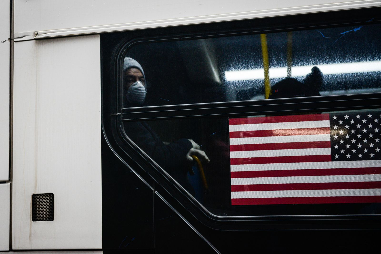 Riding a bus in Brooklyn on Sunday, March 29, 2020, amid the coronavirus pandemic. (Marian Carrasquero/The New York Times)