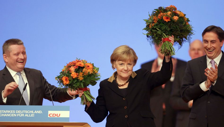 Angela Merkel being feted after her record re-election result as party leader.