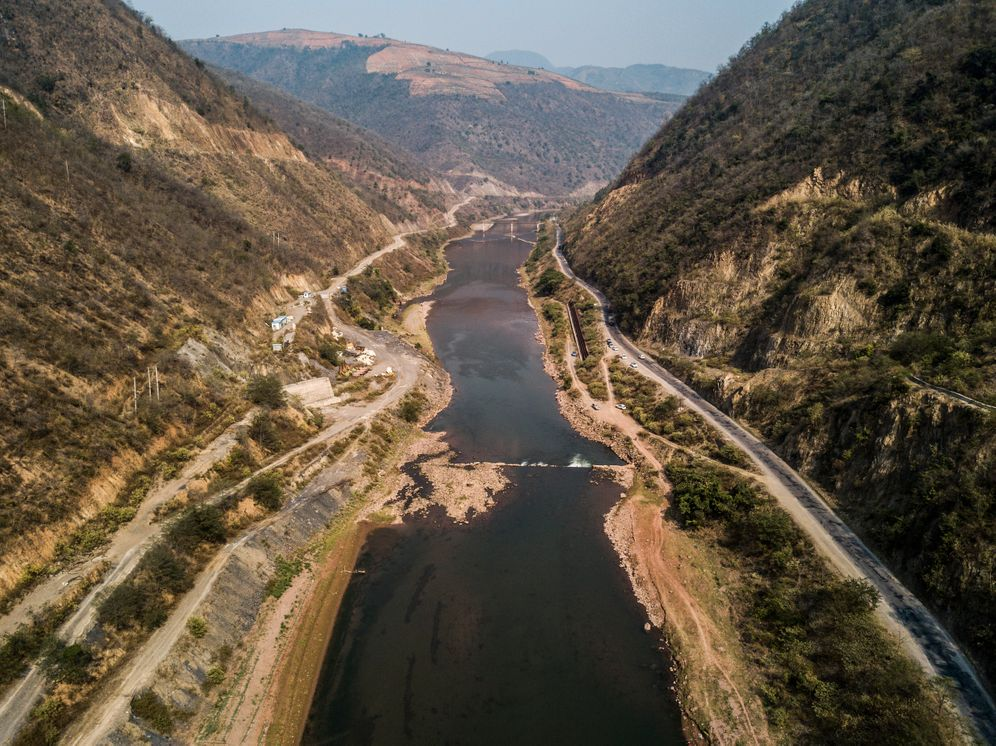 The uncompleted dam has been largely removed, allowing the river to continue flowing freely through the valley.