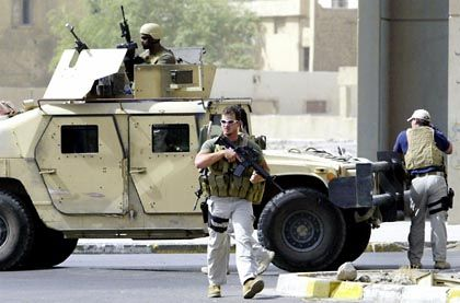 Blackwater employees secure a site in Baghdad in this July 2005 file photo.