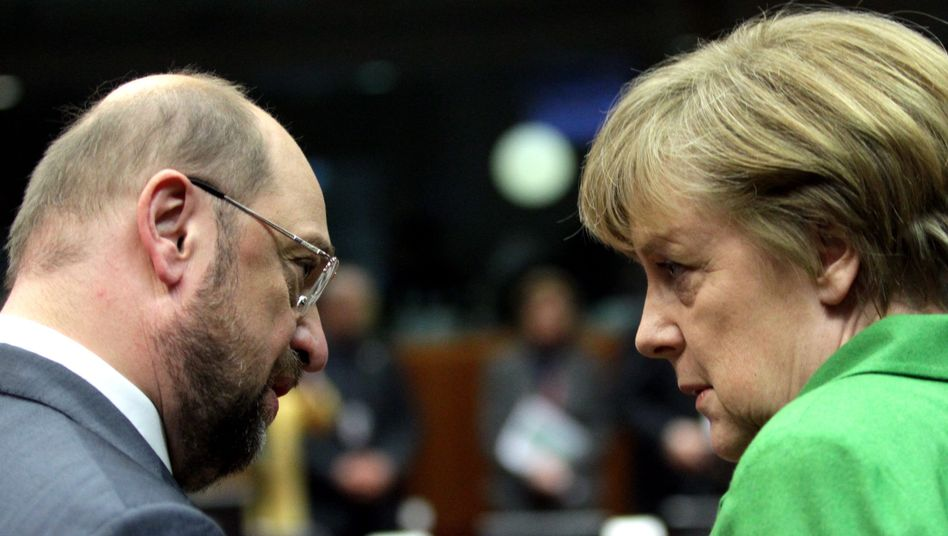 German Federal Chancellor Angela Merkel chats with European Parliament President Martin Schulz -- an unexpected new friend.