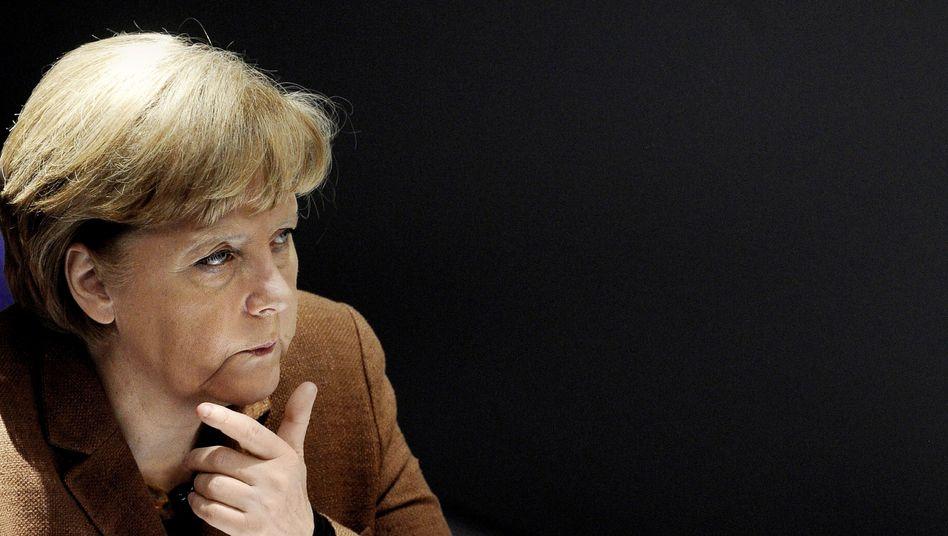 Kanzlerin und CDU-Chefin Merkel: Schwere Zeiten für Schwarz-Gelb