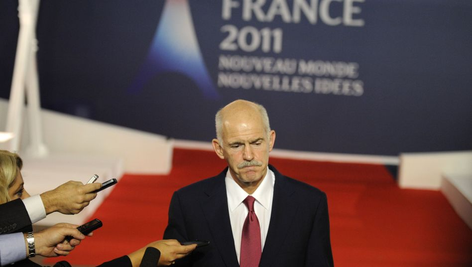 Greek Prime Minister Georgis Papandreou faces the press after crisis talks on the euro at the G-20 summit in Cannes on Wednesday.