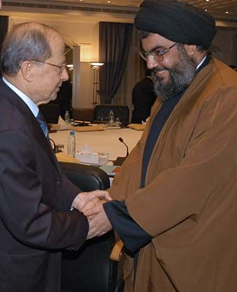 Unlikely political partners: Christian leader Michel Aoun (left) and Hezbollah leader Sheikh Hassan Nasrallah in Beirut.
