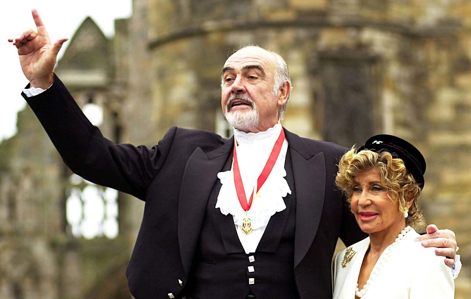 SIR SEAN CONNERY AND HIS WIFE POSE FOR PHOTOGRAPHS IN EDINBURGH.