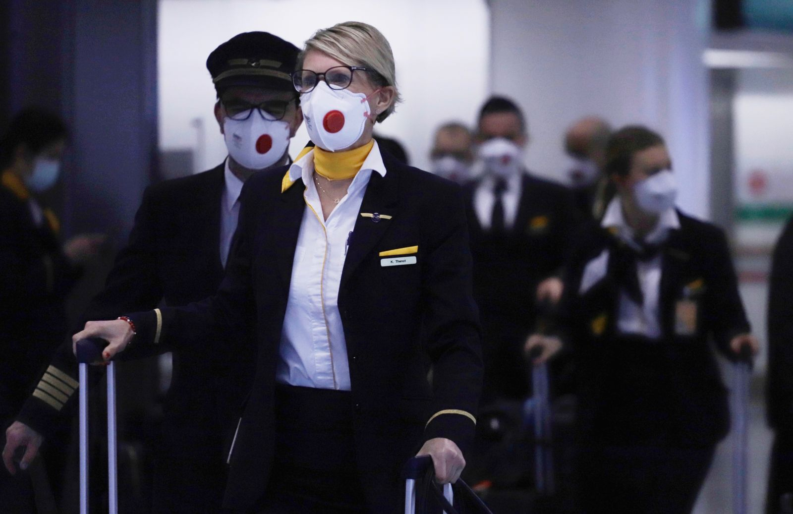 China Pneumonia Outbreak 2020 / Lufthansa masked cabin crew / HK