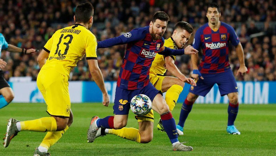 Lionel Messi (Mitte) war von der BVB-Abwehr nicht zu halten