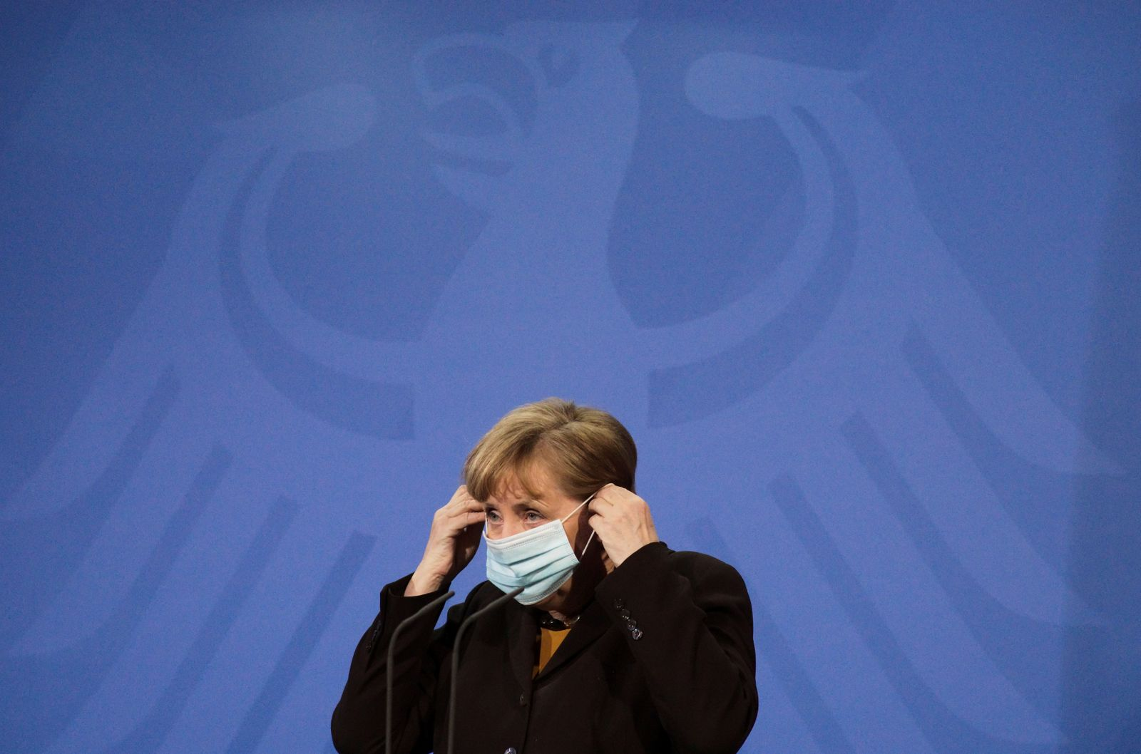 FILE PHOTO: German Chancellor Angela Merkel briefs the media after a virtual meeting with federal state governors at the chancellery in Berlin