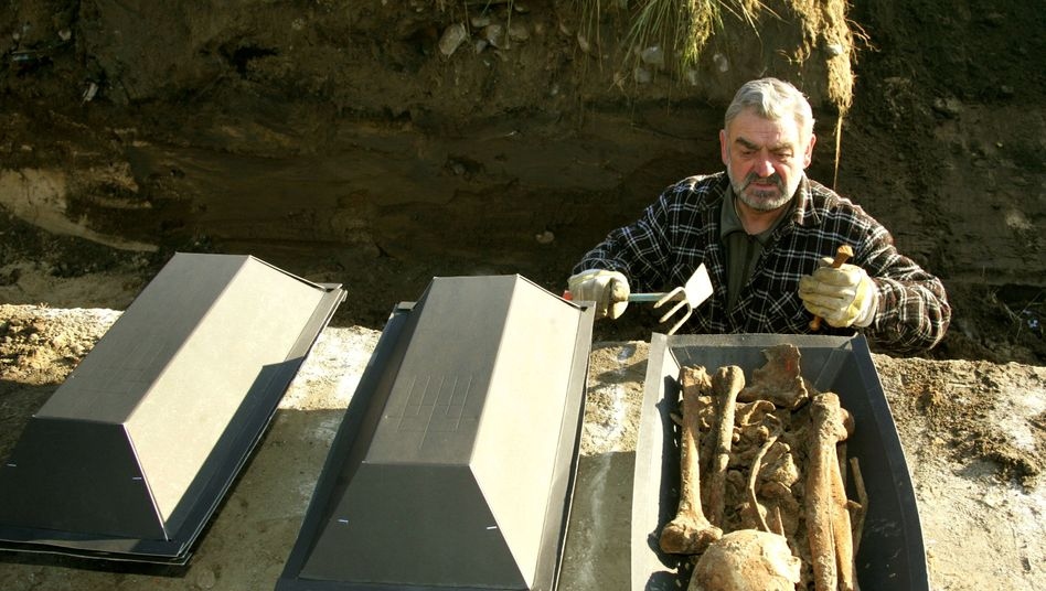 Digging for human bones: Erwin Kowalke's job is to find some of the thousands of soldiers who died during World War II, identify them and then accord them a proper burial.