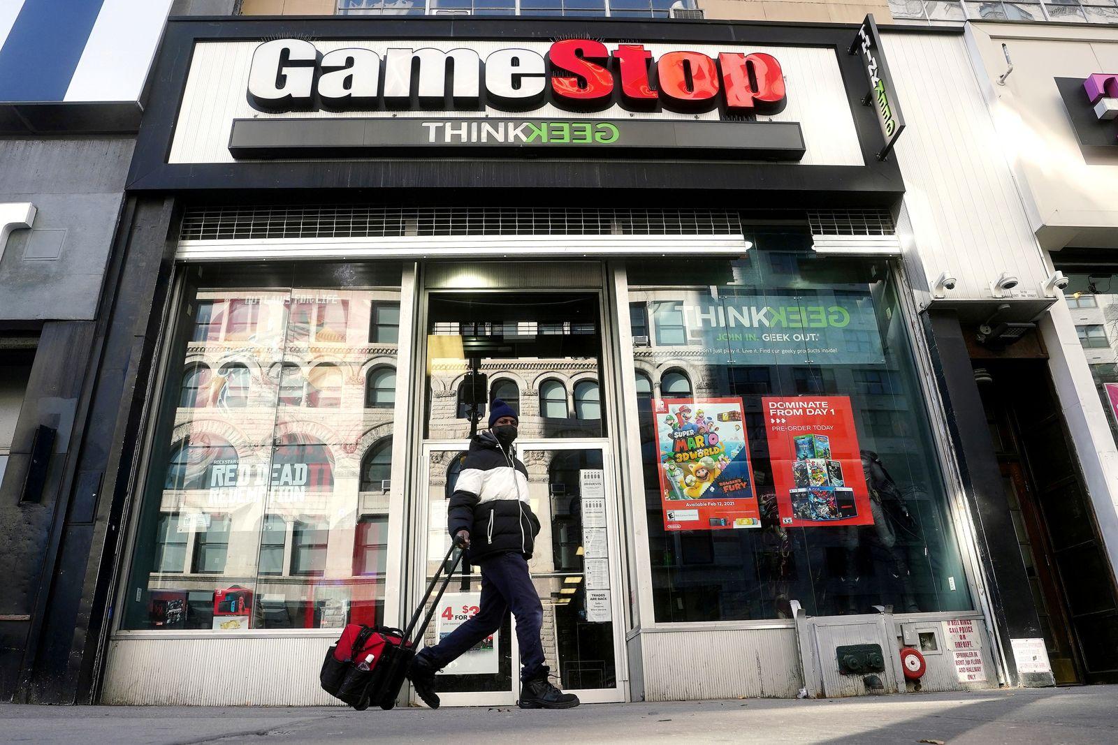 FILE PHOTO: FILE PHOTO: A person walks past a GameStop in New York
