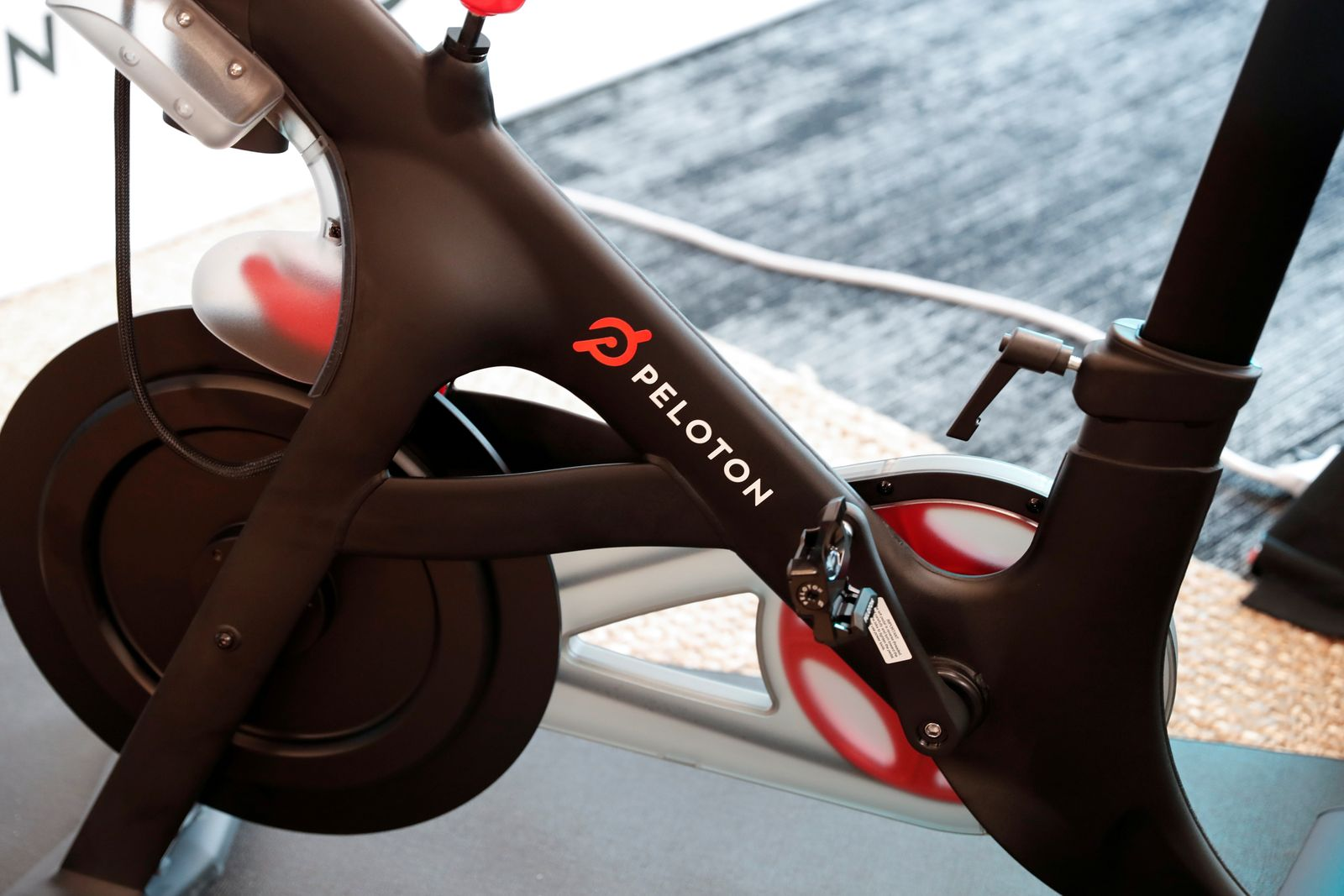 FILE PHOTO: A Peloton exercise bike is seen after the ringing of the opening bell for the company's IPO at the Nasdaq Market site in New York City