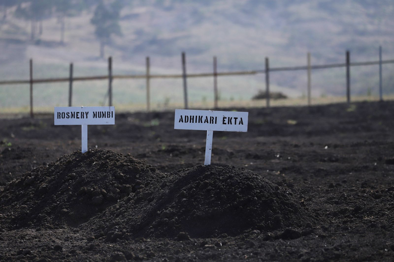 Signs with the names of victims of Ethiopian Airlines Flight ET302 Boeing 737 Max crash are seen during a memorial service at the crash site near Bishoftu